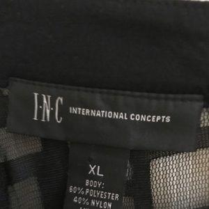 Black sleeveless top by INC,